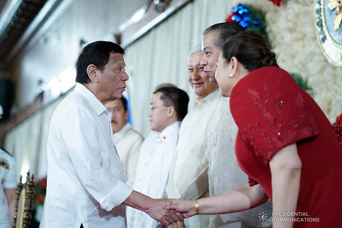 President Rodrigo Roa Duterte greets House Majority Leader Martin Romualdez and Negros Occidental Fourth District Representative Juliet Ferrer during the ceremonial signing of the Postponement of the 2020 Barangay and Sangguniang Kabataan Elections Act and the Malasakit Center Act at the Malacañan Palace on December 3, 2019. KING RODRIGUEZ/PRESIDENTIAL PHOTO