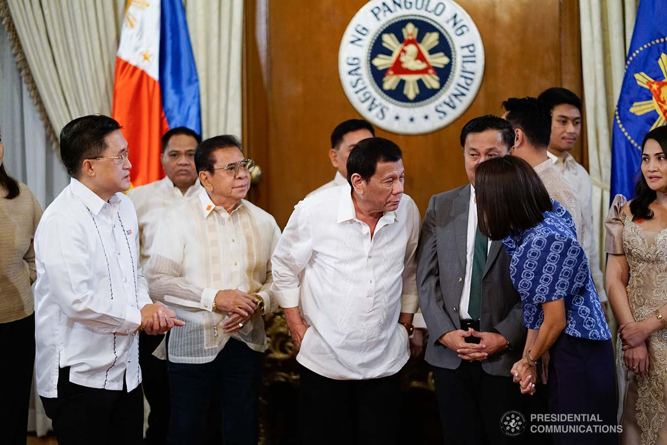 President Rodrigo Roa Duterte chats with one of the newly-elected officers of the League of Municipalities of the Philippines following their oath-taking ceremony at the Malacañan Palace on December 3, 2019. KING RODRIGUEZ/PRESIDENTIAL PHOTO