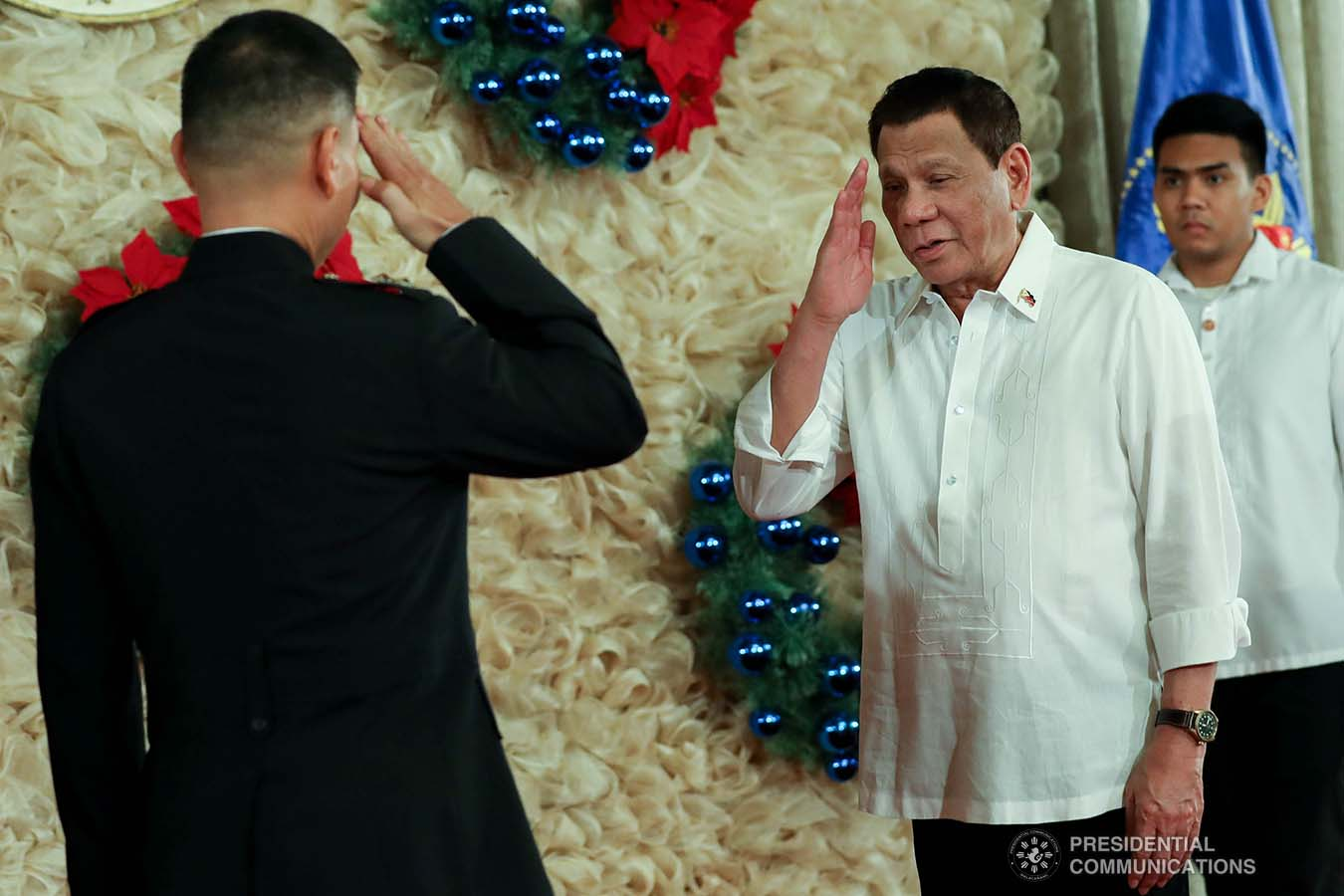 President Rodrigo Roa Duterte salutes one of the newly-appointed flag officers of the Armed Forces of the Philippines during the oath-taking ceremony at the Malacañan Palace on December 9, 2019. ROBINSON NIÑAL JR./PRESIDENTIAL PHOTO