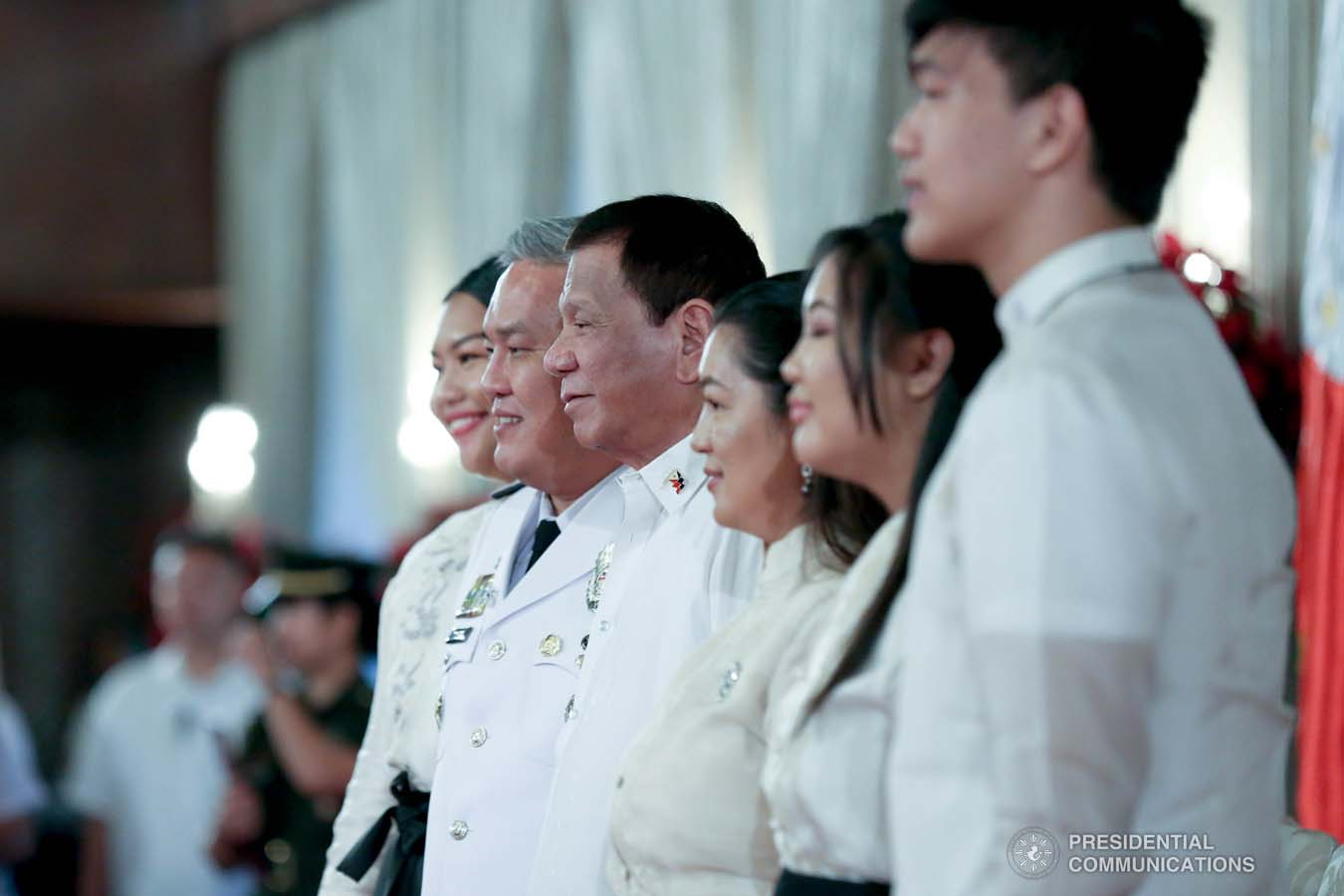 President Rodrigo Roa Duterte poses for posterity with newly promoted Jail Chief Superintendent Clement Laboy and his family during the oath-taking ceremony at the Malacañan Palace on December 10, 2019. SIMEON CELI JR./PRESIDENTIAL PHOTO