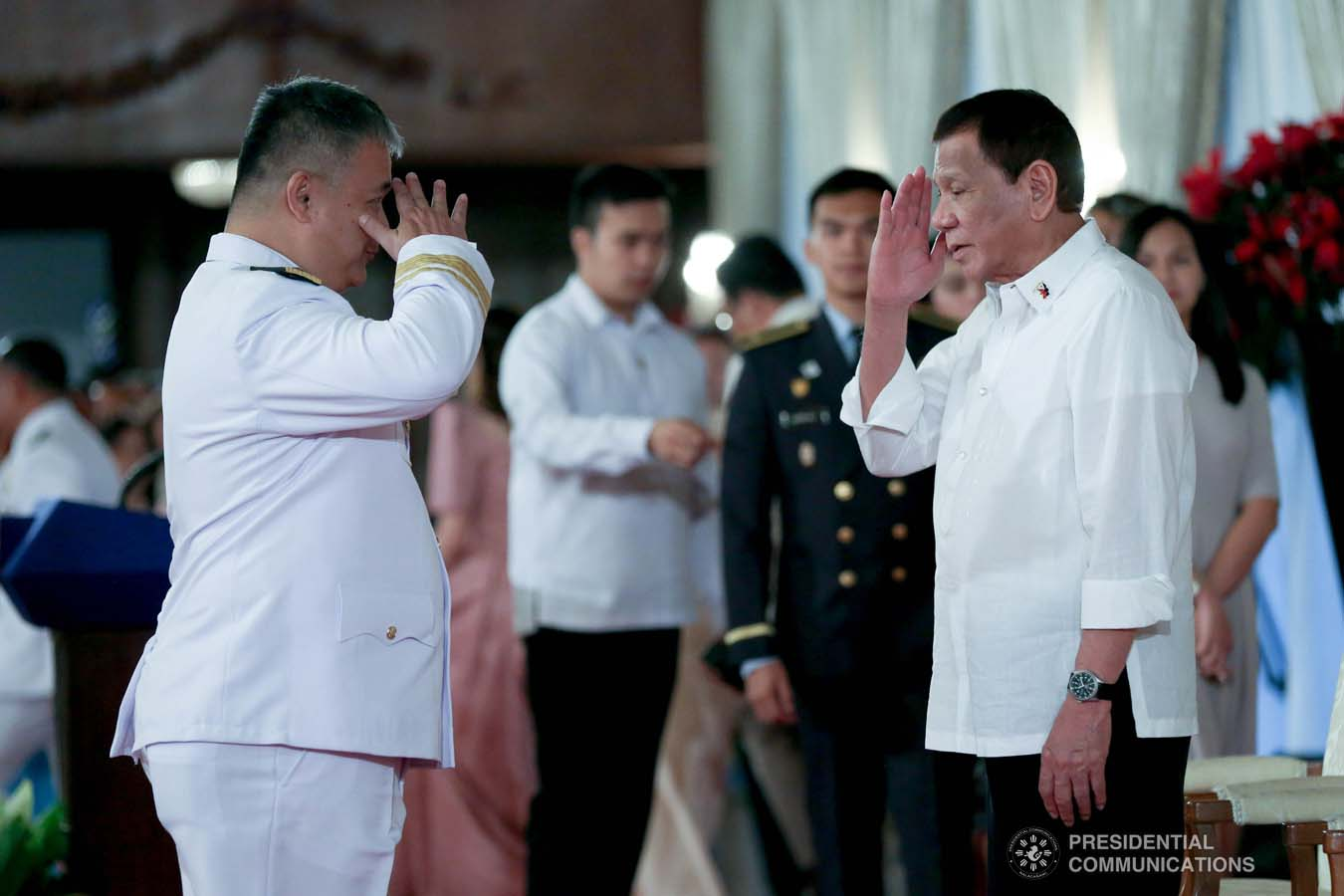 President Rodrigo Roa Duterte salutes one of the newly promoted uniformed personnel of the Philippine Coast Guard during the oath-taking ceremony at the Malacañan Palace on December 10, 2019. SIMEON CELI JR./PRESIDENTIAL PHOTO