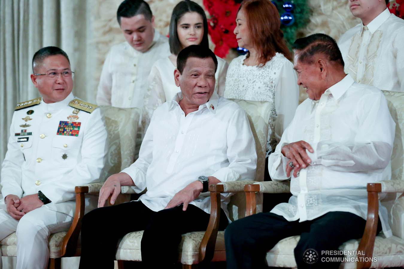 President Rodrigo Roa Duterte shares a light moment with a family member of newly promoted Vice Admiral Joel Garcia during the oath-taking ceremony at the Malacañan Palace on December 10, 2019. SIMEON CELI JR./PRESIDENTIAL PHOTO