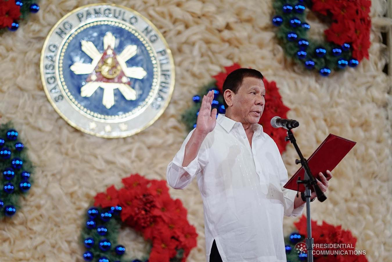 President Rodrigo Roa Duterte administers the oath of office to the newly promoted uniformed personnel of the Bureau of Fire Protection, Bureau of Jail Management and Penology and Philippine Coast Guard at the Malacañan Palace on December 10, 2019. KING RODRIGUEZ/PRESIDENTIAL PHOTO