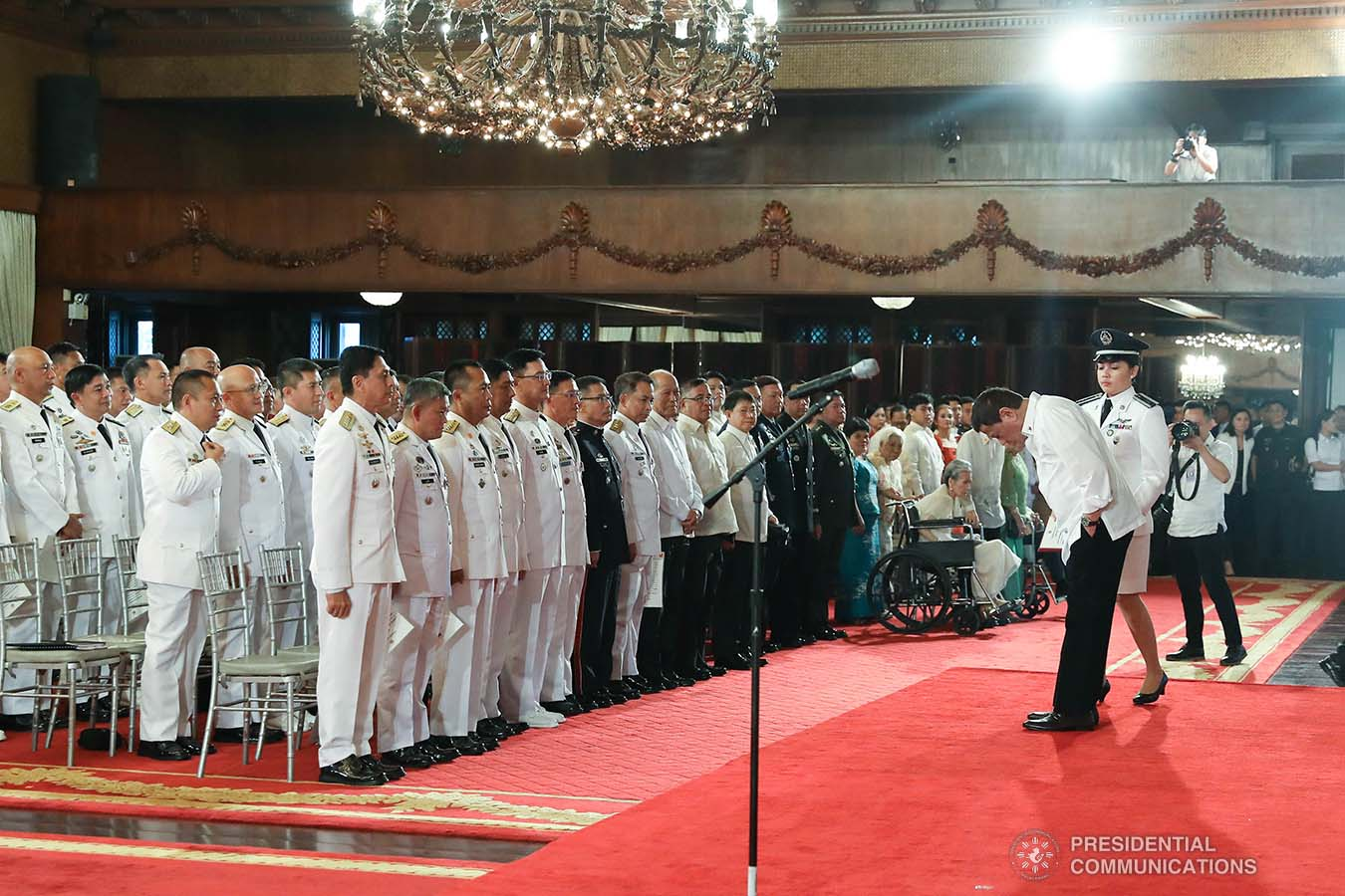 President Rodrigo Roa Duterte takes a bow before the newly-appointed flag officers of the Armed Forces of the Philippines and star-ranked officers of the Philippine National Police during the oath-taking ceremony at the Malacañan Palace on December 9, 2019. REY BANIQUET/PRESIDENTIAL PHOTO