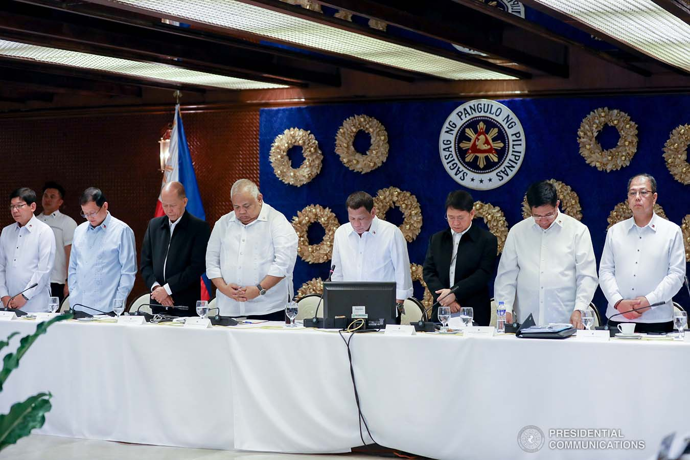 President Rodrigo Roa Duterte bows his head in prayer prior to the start of the joint Armed Forces of the Philippines-Philippine National Police (AFP-PNP) Command Conference at the Malacañan Palace on December 9, 2019. KARL NORMAN ALONZO/PRESIDENTIAL