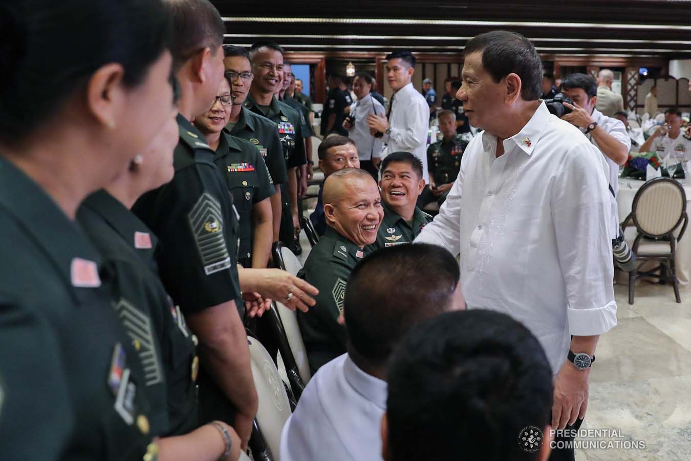 President Rodrigo Roa Duterte shares a light moment with some officers of the Armed Forces of the Philippines Council of the Sergeants Major during the Thanksgiving gathering he hosted at the Malacañan Palace on December 10, 2019. ALFRED FRIAS/PRESIDENTIAL PHOTO