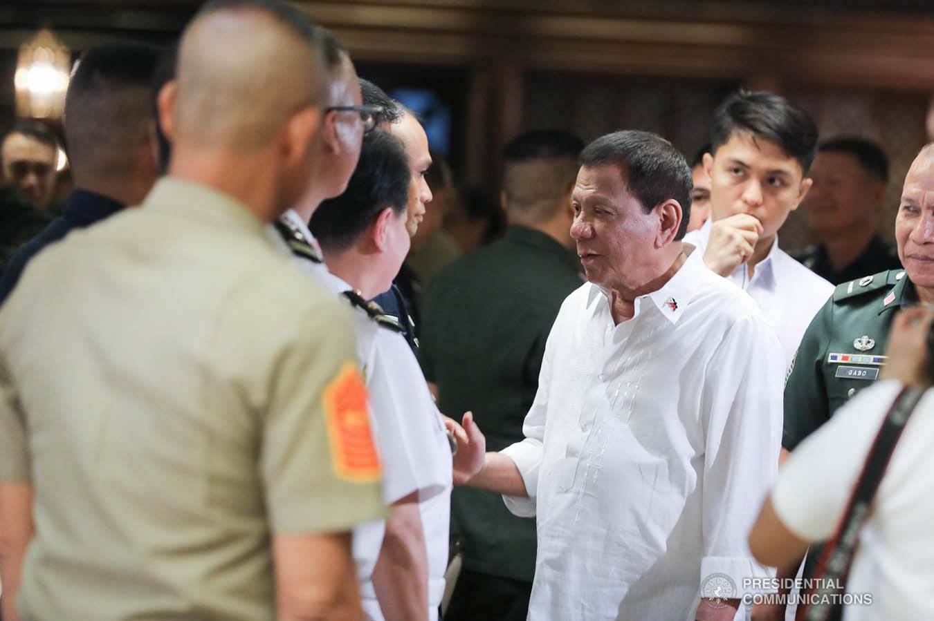 President Rodrigo Roa Duterte greets an officer of the Armed Forces of the Philippines during the Thanksgiving gathering he hosted for the AFP Council of the Sergeants Major at the Malacañan Palace on December 10, 2019. ALFRED FRIAS/PRESIDENTIAL PHOTO