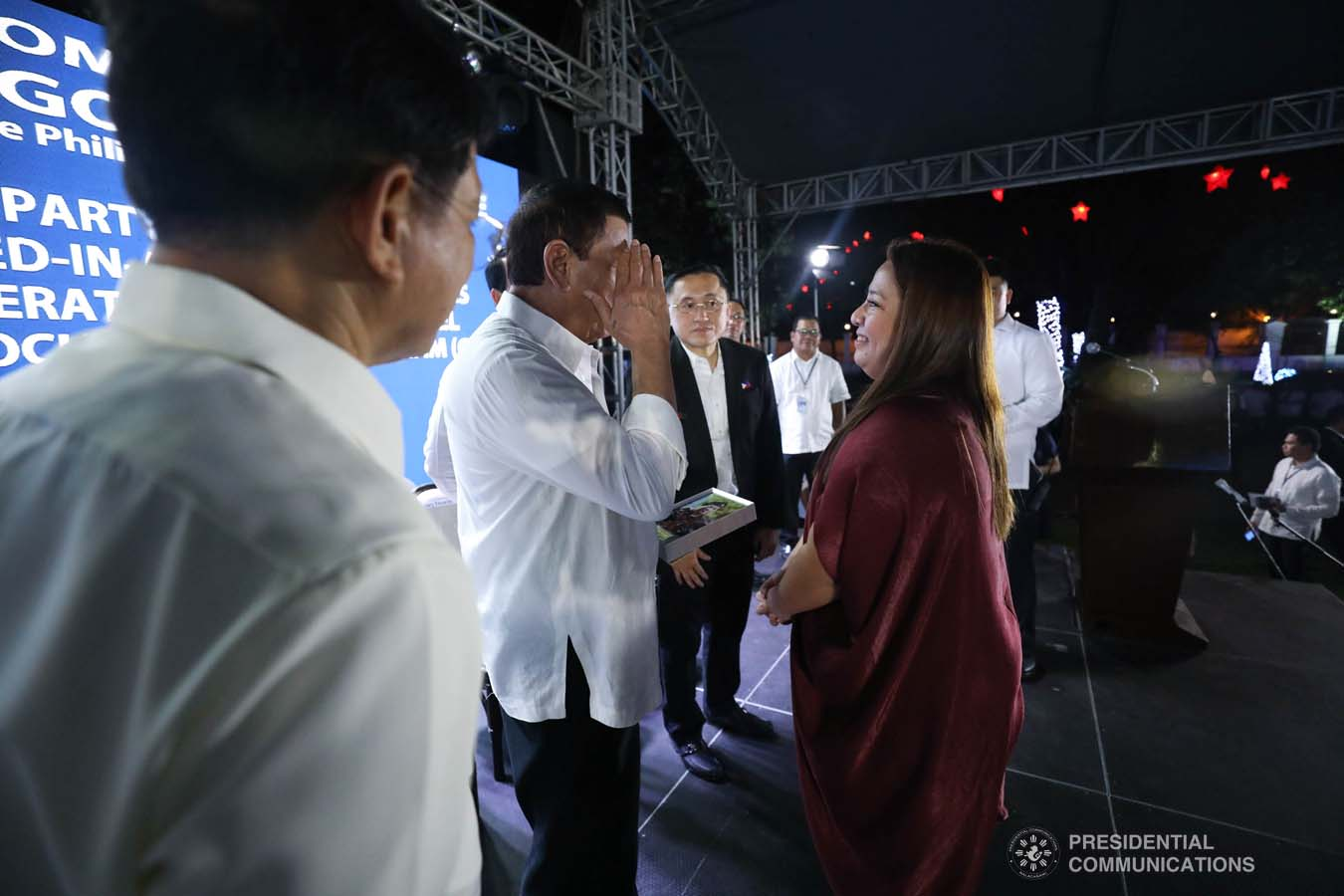 President Rodrigo Roa Duterte salutes one of the beneficiaries of the killed-in-action (KIA) soldiers and killed-in-police operation (KIPO) personnel under the Comprehensive Social Benefits Program during the Thanksgiving party at the Malacañan Palace on December 10, 2019. SIMEON CELI JR./PRESIDENTIAL PHOTO