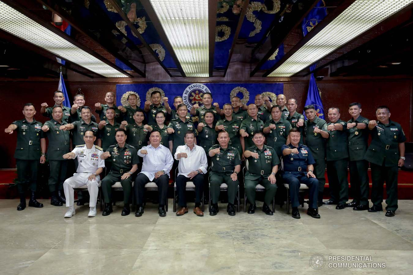 President Rodrigo Roa Duterte flashes his signature pose with officers of the Armed Forces of the Philippines Council of the Sergeants Major during the Thanksgiving gathering he hosted at the Malacañan Palace on December 10, 2019. SIMEON CELI JR./PRESIDENTIAL PHOTO