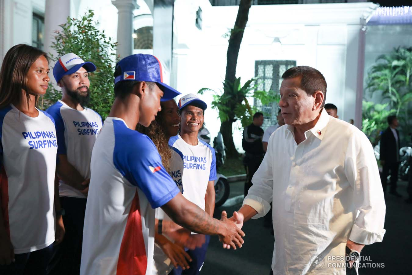 President Rodrigo Roa Duterte greets Southeast Asian Games gold medalist Roger Casugay during the meeting with the Philippine Surfing Team at the Malacañan Palace on December 10, 2019. RICHARD MADELO/PRESIDENTIAL PHOTO