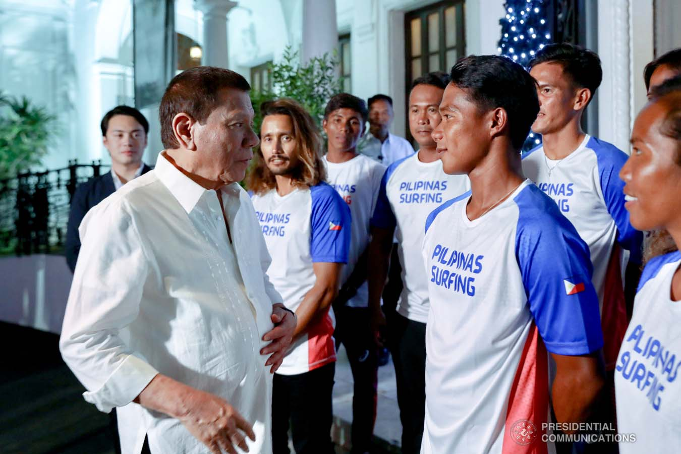 President Rodrigo Roa Duterte chats with Southeast Asian Games gold medalist Roger Casugay during the meeting with the Philippine Surfing Team at the Malacañan Palace on December 10, 2019. RICHARD MADELO/PRESIDENTIAL PHOTO