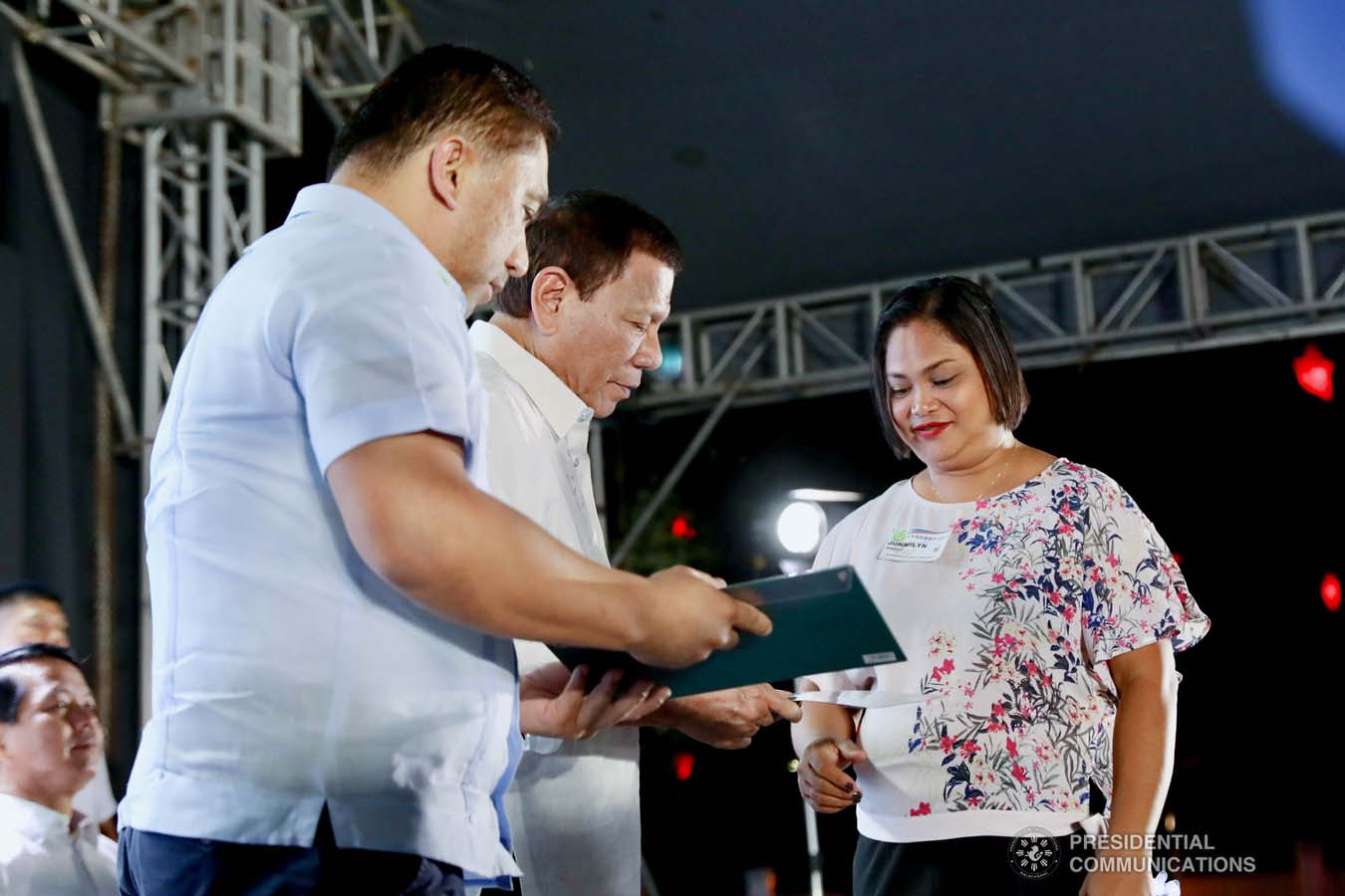 President Rodrigo Roa Duterte leads the ceremonial turnover of housing certificates and checks to the beneficiaries of the killed-in-action (KIA) soldiers and killed-in-police operation (KIPO) personnel under the Comprehensive Social Benefits Program during the Thanksgiving party at the Malacañan Palace on December 10, 2019. Assisting the President is National Housing Authority General Manager Marcelino Escalada Jr. RICHARD MADELO/PRESIDENTIAL PHOTO