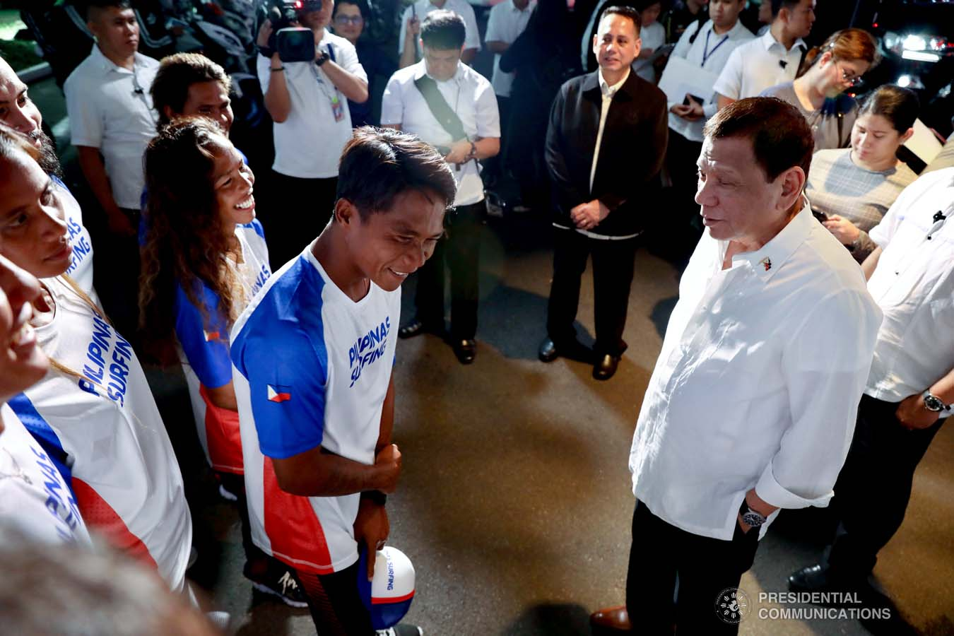 President Rodrigo Roa Duterte shares a light moment with Southeast Asian Games gold medalist Roger Casugay during a meeting with the Philippine Surfing Team at the Malacañan Palace on December 10, 2019. RICHARD MADELO/PRESIDENTIAL PHOTO
