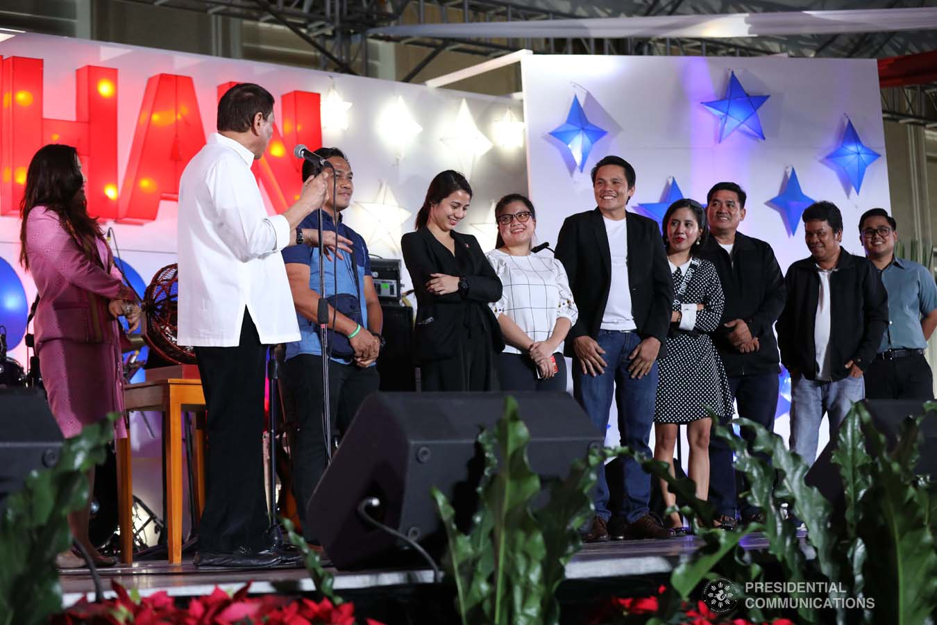 President Rodrigo Roa Duterte shares a light moment with the winners of the raffle during the Office of the President Christmas Party at the Malacañan Palace on December 18, 2019. SIMEON CELI JR./PRESIDENTIAL PHOTO