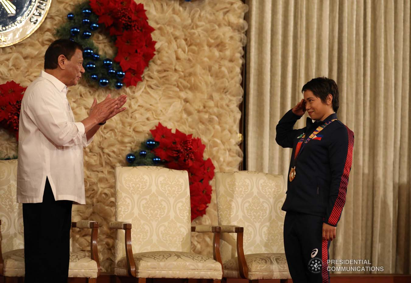 President Rodrigo Roa Duterte gets a salute from weightlifting gold medalist Hidilyn Diaz during the awarding of the Order of Lapu-Lapu Rank of Kamagi to the 2019 Southeast Asian Games medalists at the Malacañan Palace on December 18, 2019. KARL NORMAN ALONZO/PRESIDENTIAL PHOTO