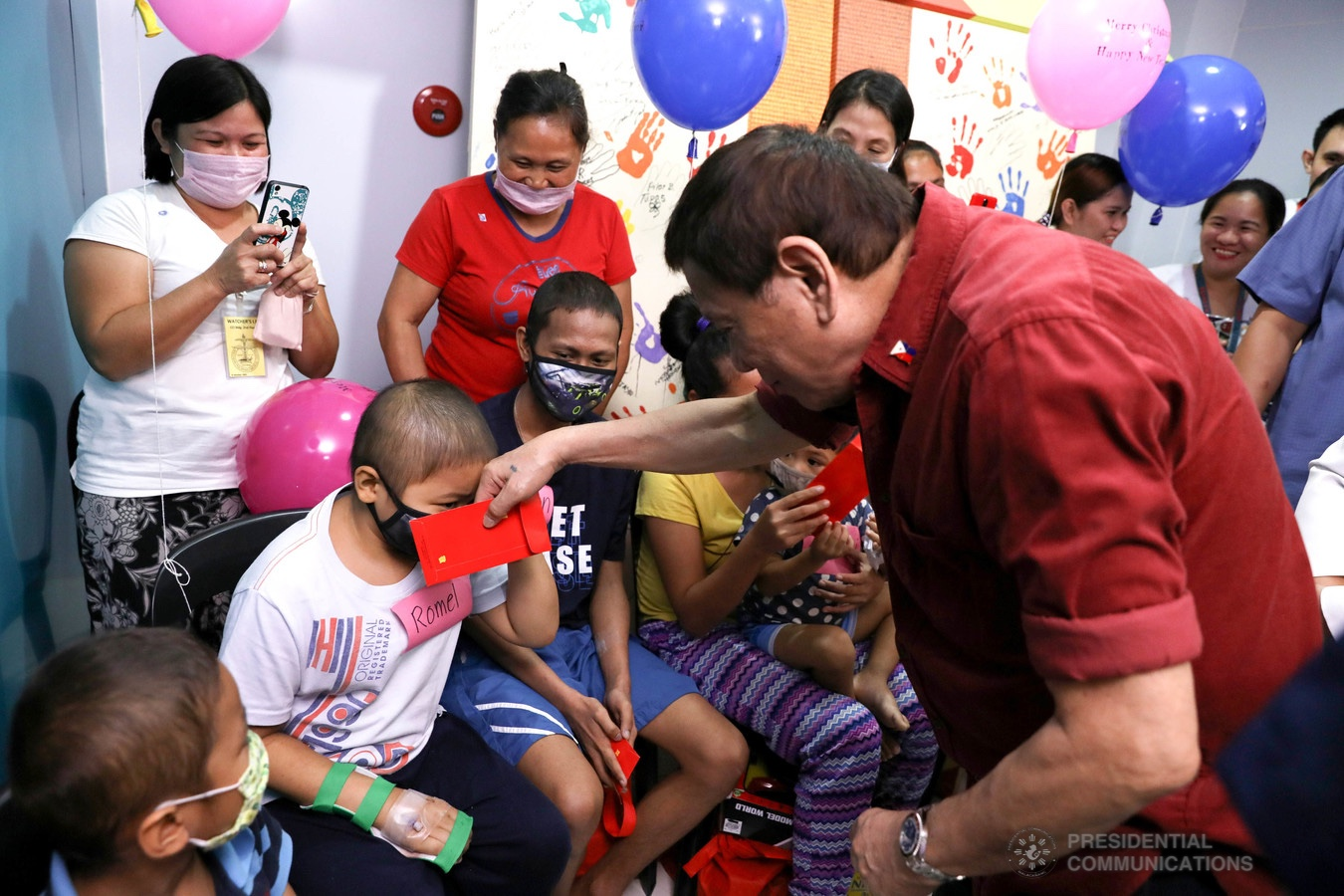 President Rodrigo Roa Duterte interacts with one of the pediatric cancer patients he visited at the Southern Philippines Medical Center Children's Cancer Institute in Davao City on December 28, 2019. KARL NORMAN ALONZO/PRESIDENTIAL PHOTO