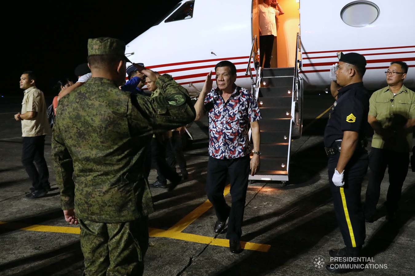 President Rodrigo Roa Duterte salutes a military officer upon his arrival at the Legazpi City Airport before heading to the Legazpi City Convention Center for the situation briefing on the effects of Typhoon Tisoy on December 5, 2019. ROBINSON NIÑAL JR./PRESIDENTIAL PHOTO