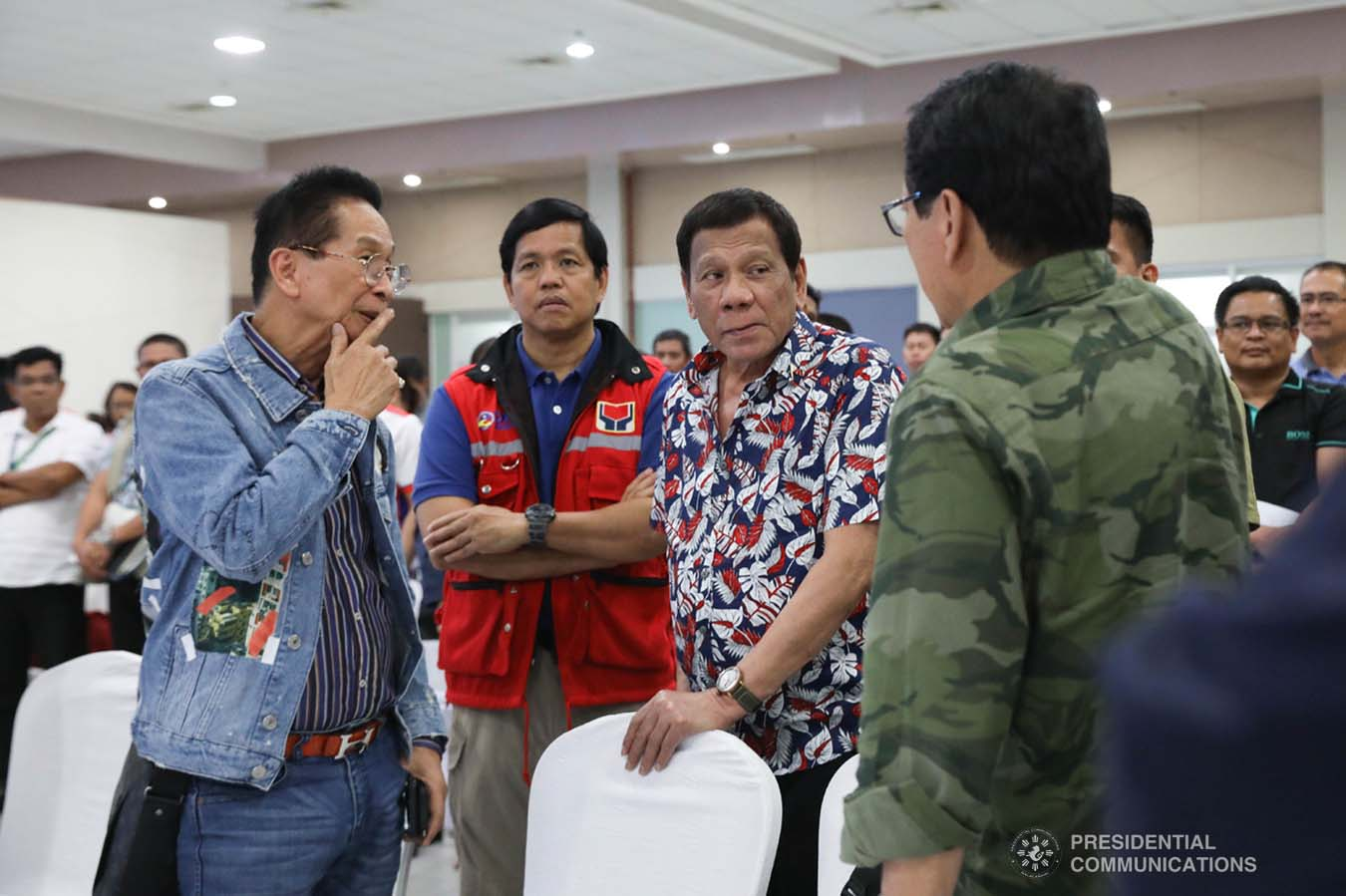 President Rodrigo Roa Duterte discusses matters with Presidential Chief Legal Counsel and Spokesperson Salvador Panelo, Social Welfare and Development Secretary Rolando Bautista and Labor and Employment Secretary Silvestre Bello III during the situation briefing on the effects of Typhoon Tisoy at the Legazpi City Convention Center on December 5, 2019. ROBINSON NIÑAL JR./PRESIDENTIAL PHOTO