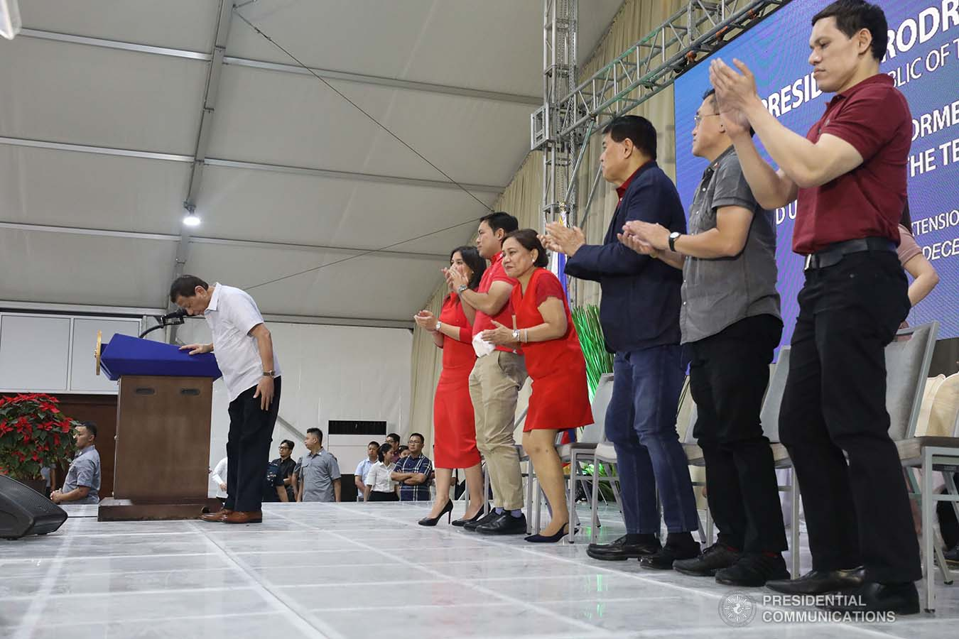President Rodrigo Roa Duterte takes a bow before the guests during the inauguration of The Tent at Vista Global South and the birthday celebration former Senate President Manuel Villar in Las Piñas City on December 12, 2019. SIMEON CELI JR./PRESIDENTIAL PHOTO