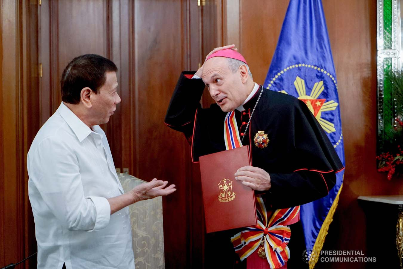President Rodrigo Roa Duterte confers the Order of Sikatuna with the Rank of Datu on outgoing Apostolic Nuncio of the Holy See to the Philippines Archbishop Gabriele Caccia during his farewell call to the President at the Malacañan Palace on December 11, 2019. KING RODRIGUEZ/PRESIDENTIAL PHOTO