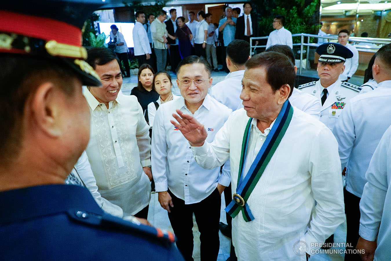 President Rodrigo Roa Duterte shares a light moment with some of the guests during the Armed Forces of the Philippines (AFP) Change of Command ceremony at Camp General Emilio Aguinaldo in Quezon City on January 4, 2020. KING RODRIGUEZ/PRESIDENTIAL PHOTO