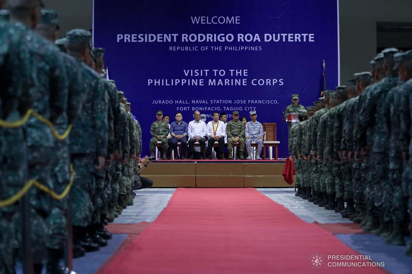 President Rodrigo Roa Duterte listens to the message of Philippine Marine Corps (PMC) Commandant Major General Nathaniel Casem during his visit to the PMC headquarters at Fort Bonifacio in Taguig City on January 13, 2020. ALFRED FRIAS/PRESIDENTIAL PHOTO