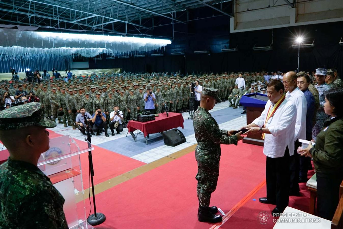President Rodrigo Roa Duterte confers the Order of Lapu-Lapu Rank of Kamagi on one of the Philippine Marine Corps (PMC) personnel during his visit to the PMC headquarters at Fort Bonifacio in Taguig City on January 13, 2020. The President honored the PMC personnel who took part in the liberation of Marawi City from the terrorists. KING RODRIGUEZ/PRESIDENTIAL PHOTO