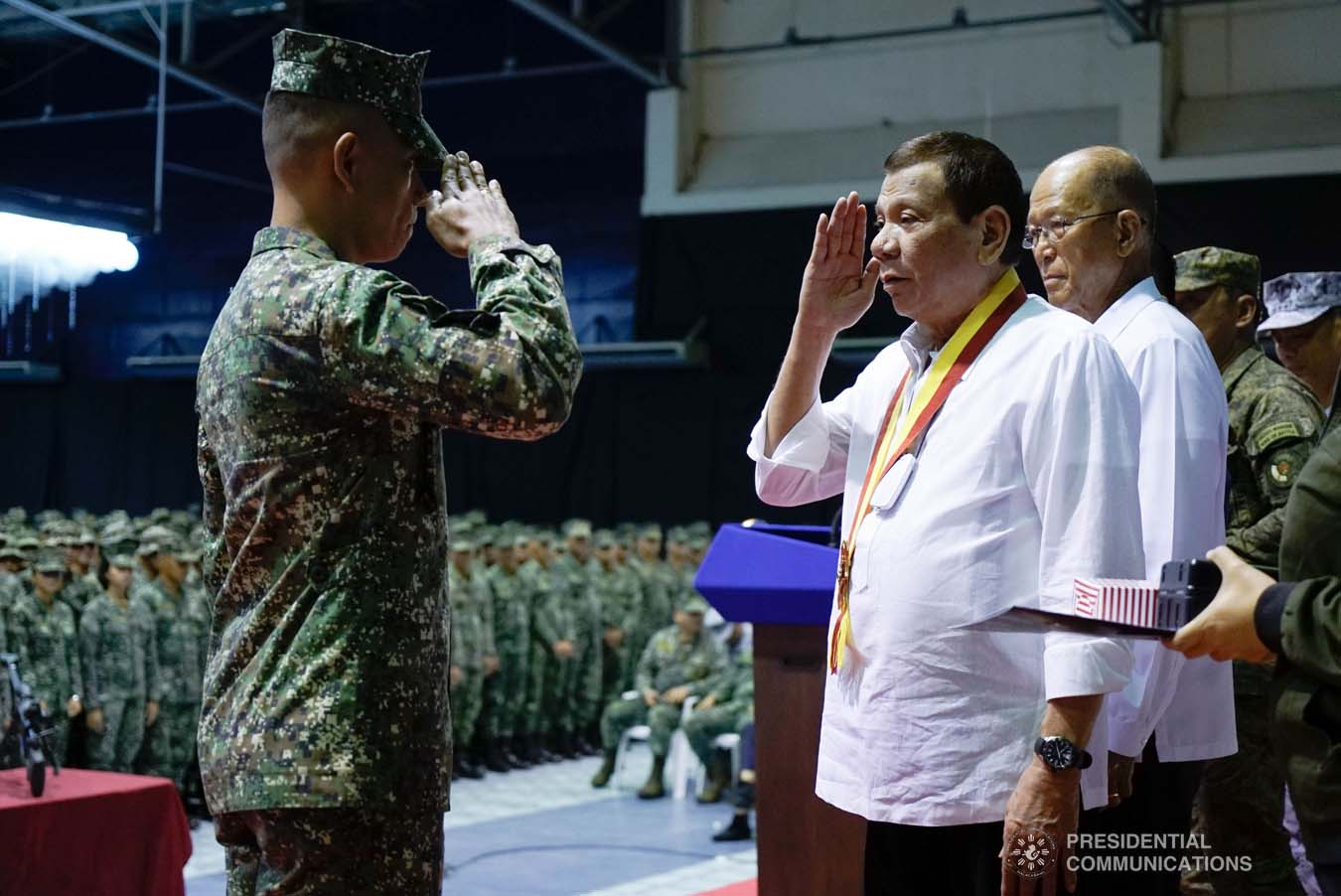 President Rodrigo Roa Duterte salutes one of the Philippine Marine Corps (PMC) personnel, who was conferred with the Order of Lapu-Lapu Rank of Kamagi, during his visit to the PMC headquarters at Fort Bonifacio in Taguig City on January 13, 2020. The President honored the PMC personnel who took part in the liberation of Marawi City from the terrorists. KING RODRIGUEZ/PRESIDENTIAL PHOTO