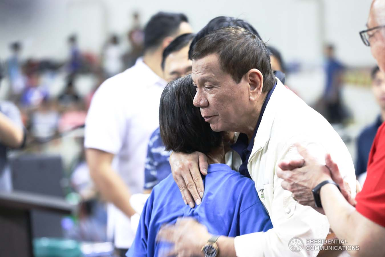 President Rodrigo Roa Duterte embraces one of the victims affected by the Taal Volcano eruption during his visit at the Batangas City Sports Coliseum on January 14, 2020. ACE MORANDANTE/PRESIDENTIAL PHOTO