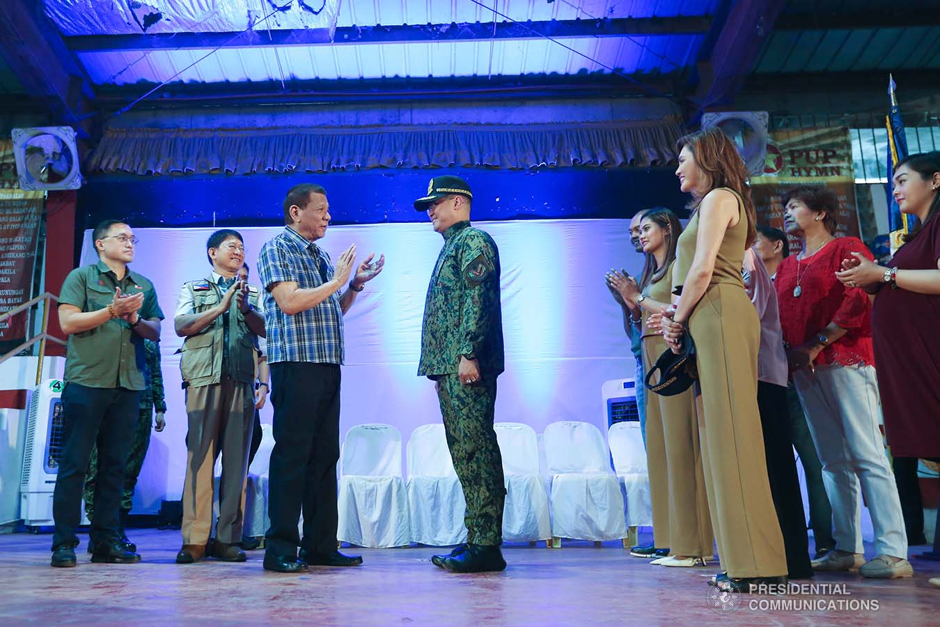 President Rodrigo Roa Duterte applauds after administering the oath to newly-appointed Philippine National Police (PNP) chief Lieutenant General Archie Gamboa during a ceremony at the Polytechnic University of the Philippines-Sto. Tomas Campus in Sto. Tomas City, Batangas on January 20, 2020. VALERIE ESCALERA/PRESIDENTIAL PHOTO