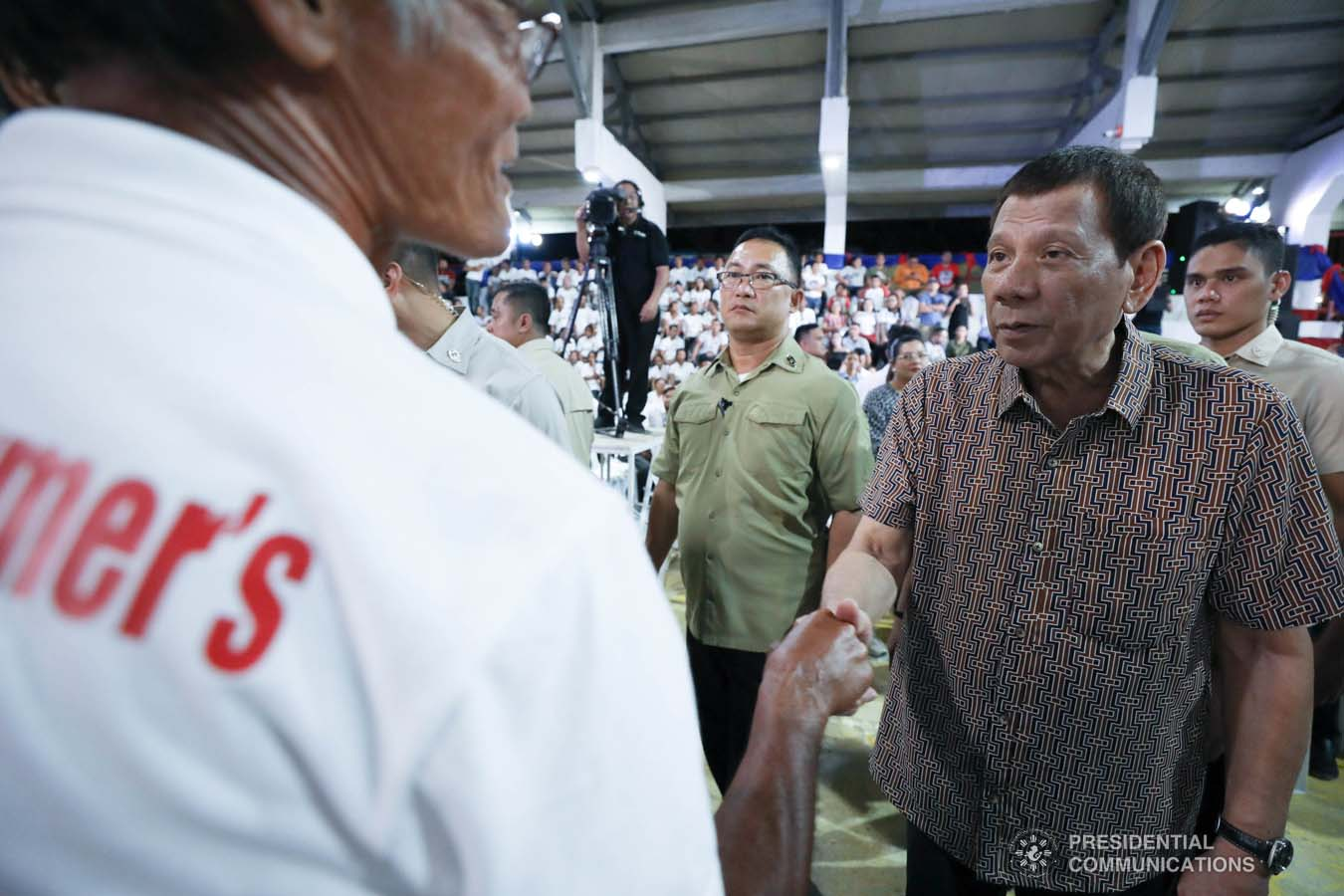 President Rodrigo Roa Duterte greets former rebels before distributing their benefits during a ceremony at the San Isidro Central School in Leyte on January 23, 2020. KARL NORMAN ALONZO/PRESIDENTIAL PHOTO