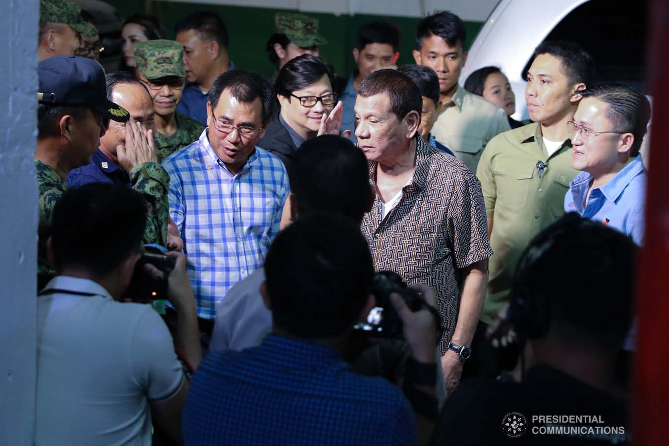 President Rodrigo Roa Duterte salutes a military officer upon his arrival at the San Isidro Central School to lead the distribution of benefits to former rebels in Leyte on January 23, 2020. VALERIE ESCALERA/PRESIDENTIAL PHOTO