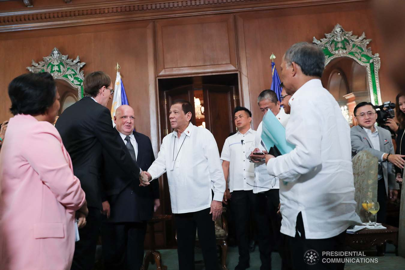 President Rodrigo Roa Duterte greets the members of the delegation of outgoing New Zealand Ambassador to the Philippines David Strachan, who paid a farewell call on the President at the Malacañan Palace on January 27, 2020. ALFRED FRIAS/PRESIDENTIAL PHOTO