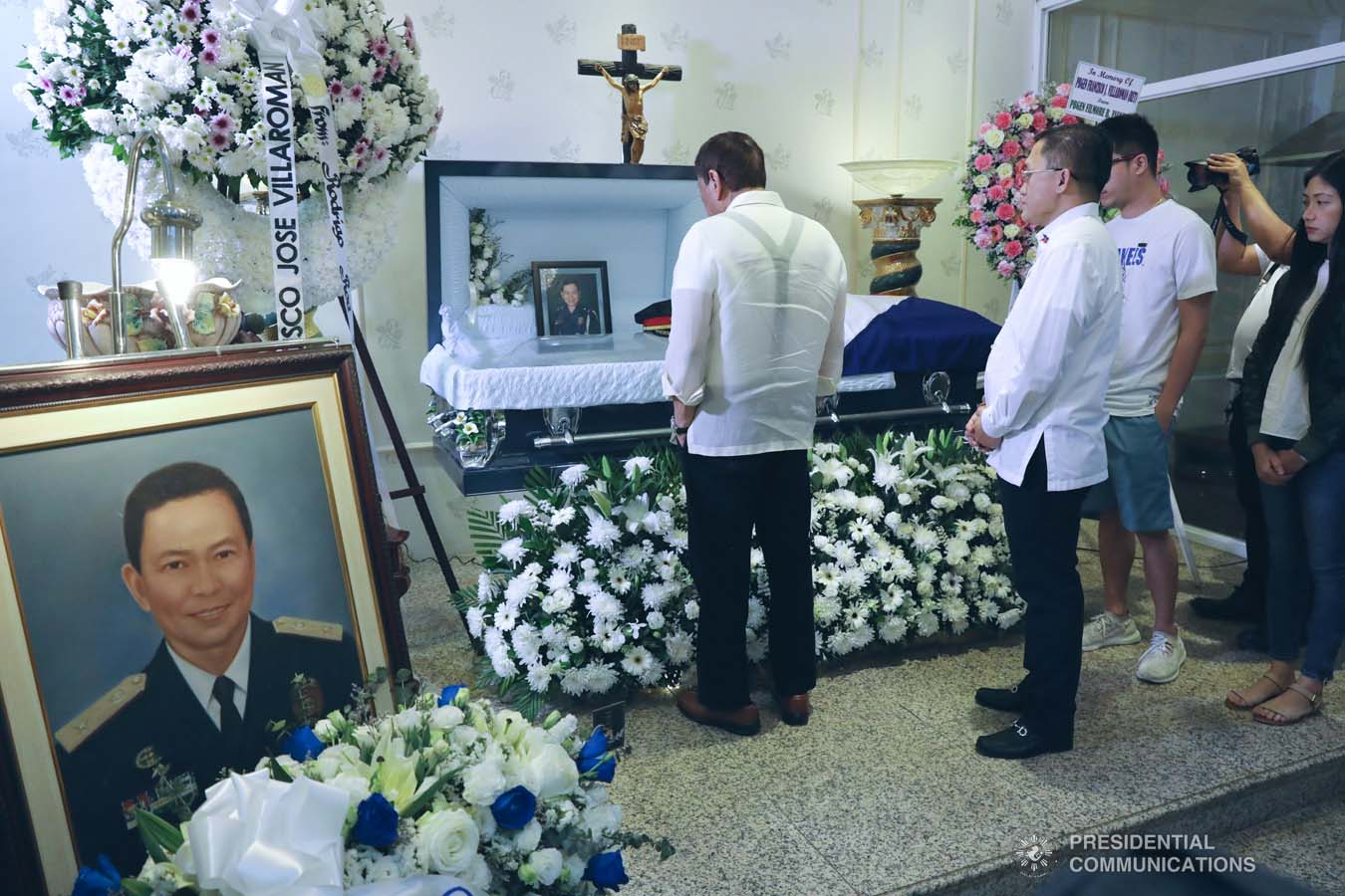 President Rodrigo Roa Duterte pays his last respects to the late Retired Police General Francisco Villaroman as he visited the wake at the Cosmopolitan Funeral Homes in Davao City on January 17, 2020. ROBINSON NIÑAL JR./PRESIDENTIAL PHOTO