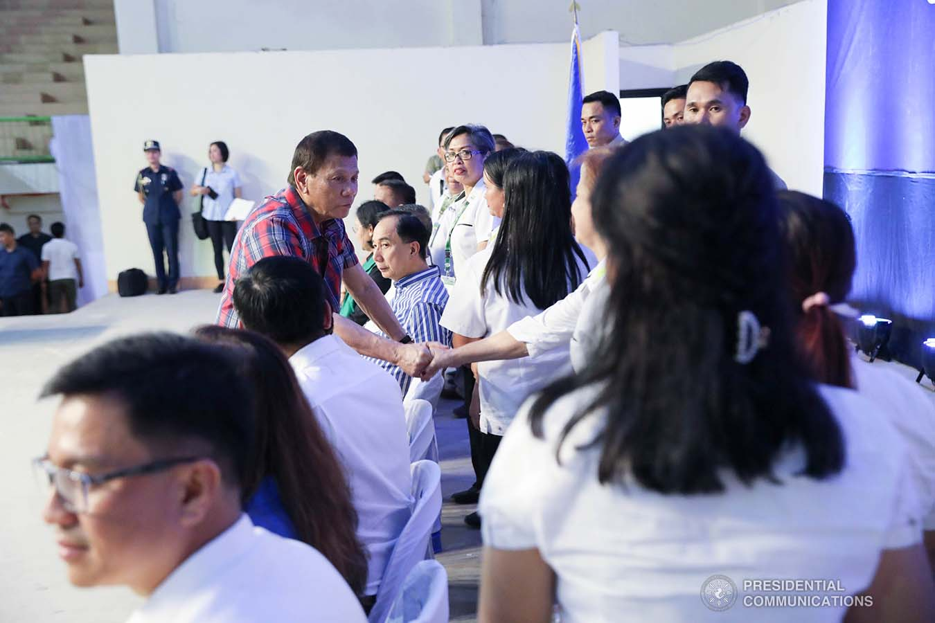 President Rodrigo Roa Duterte greets some of the guests during the ceremonial distribution of agricultural assistance to the farmers of Region 12 at the Pigcawayan Municipal Gymnasium in Cotabato on January 10, 2020. ROBINSON NIÑAL JR./PRESIDENTIAL PHOTO