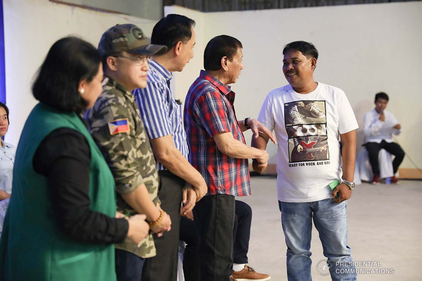 """President Rodrigo Roa Duterte leads the ceremonial distribution of agricultural assistance to the farmers of Region 12 at the Pigcawayan Municipal Gymnasium in Cotabato on January 10, 2020. Also in photo are Senator Christopher """"Bong"""" Go and Agriculture Secretary William Dar. SIMEON CELI JR./PRESIDENTIAL PHOTO"""