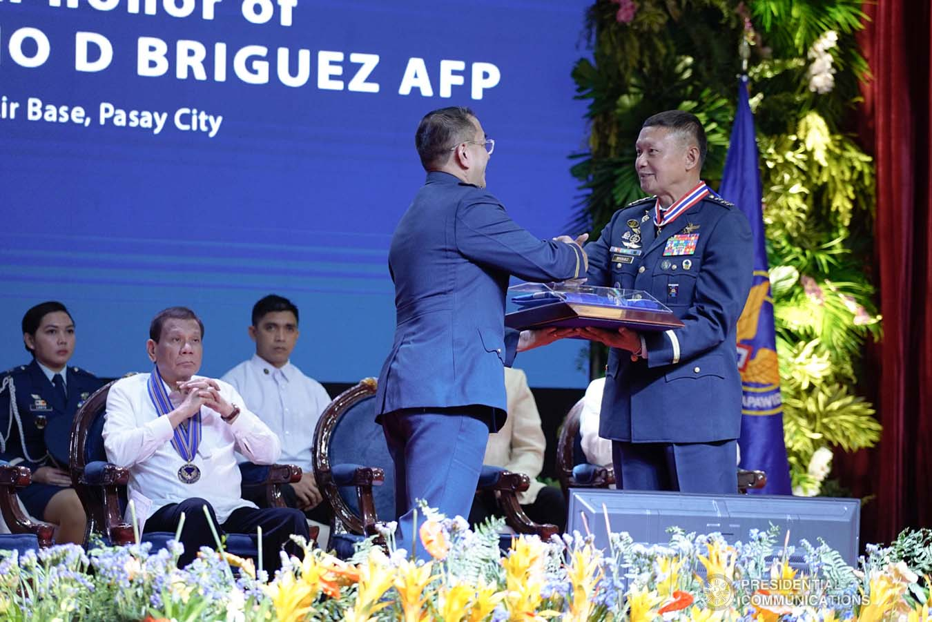 President Rodrigo Roa Duterte looks on as outgoing Philippine Air Force (PAF) Commanding General Lieutenant General Rozzano Briguez receives a command memento from incoming PAF Commanding General Major General Allen Paredes during the PAF Change of Command ceremony at the Col. Jesus Villamor Air Base in Pasay City on January 16, 2020. KING RODRIGUEZ/PRESIDENTIAL PHOTO
