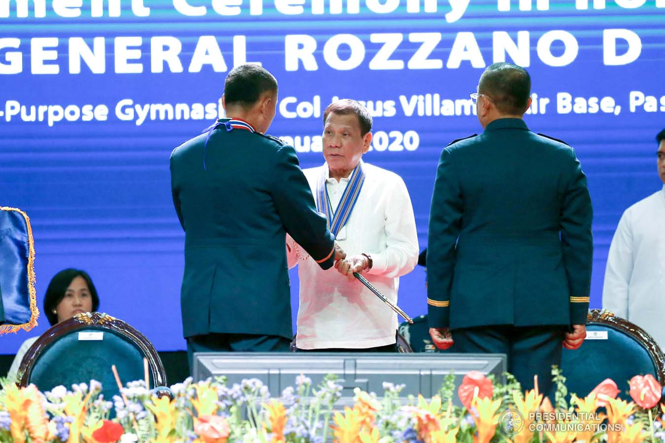 President Rodrigo Roa Duterte receives the command saber from outgoing Philippine Air Force (PAF) Commanding General Lieutenant General Rozzano Briguez during the PAF Change of Command ceremony at the Col. Jesus Villamor Air Base in Pasay City on January 16, 2020. KARL NORMAN ALONZO/PRESIDENTIAL PHOTO