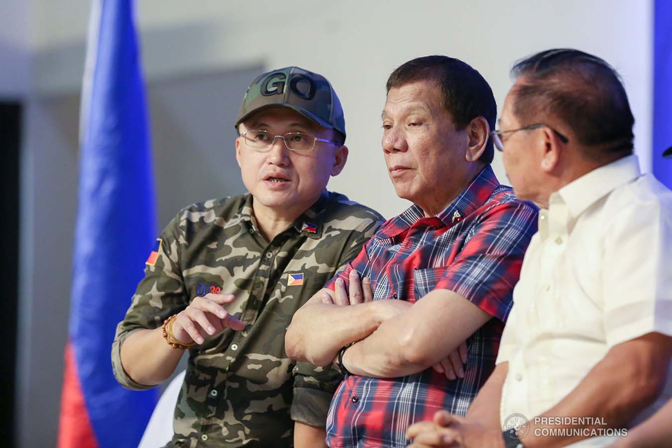 """President Rodrigo Roa Duterte chats with Senator Christopher """"Bong"""" Go during the ceremonial distribution of agricultural assistance to the farmers of Region 12 at the Pigcawayan Municipal Gymnasium in Cotabato on January 10, 2020. RICHARD MADELO/PRESIDENTIAL PHOTO"""