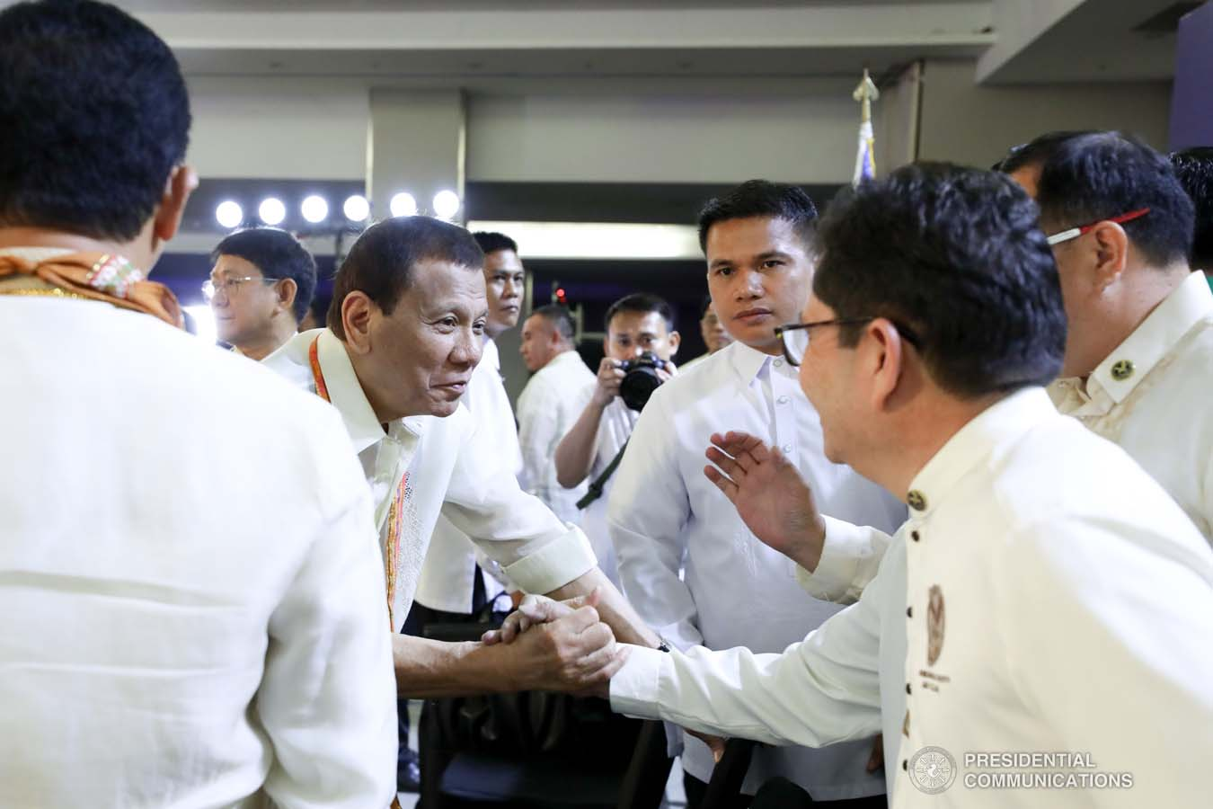 President Rodrigo Roa Duterte greets one of the guests during the thanksgiving gathering with The Fraternal Order of Eagles (TFOE) at the SMX Convention Center in Davao City on January 17, 2020. RICHARD MADELO/PRESIDENTIAL PHOTO