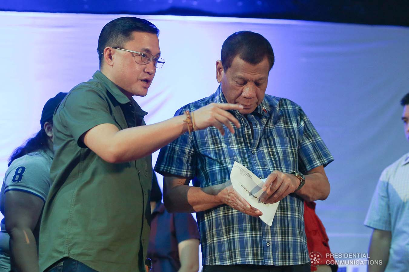 """President Rodrigo Roa Duterte prepares to hand over the calamity assistance for the Provincial Government of Batangas during his visit to the families affected by the Taal Volcano eruption at the Polytechnic University of the Philippines-Sto. Tomas Campus in Sto. Tomas City, Batangas on January 20, 2020. With the President is Senator Christopher """"Bong"""" Go. VALERIE ESCALERA/PRESIDENTIAL PHOTO"""