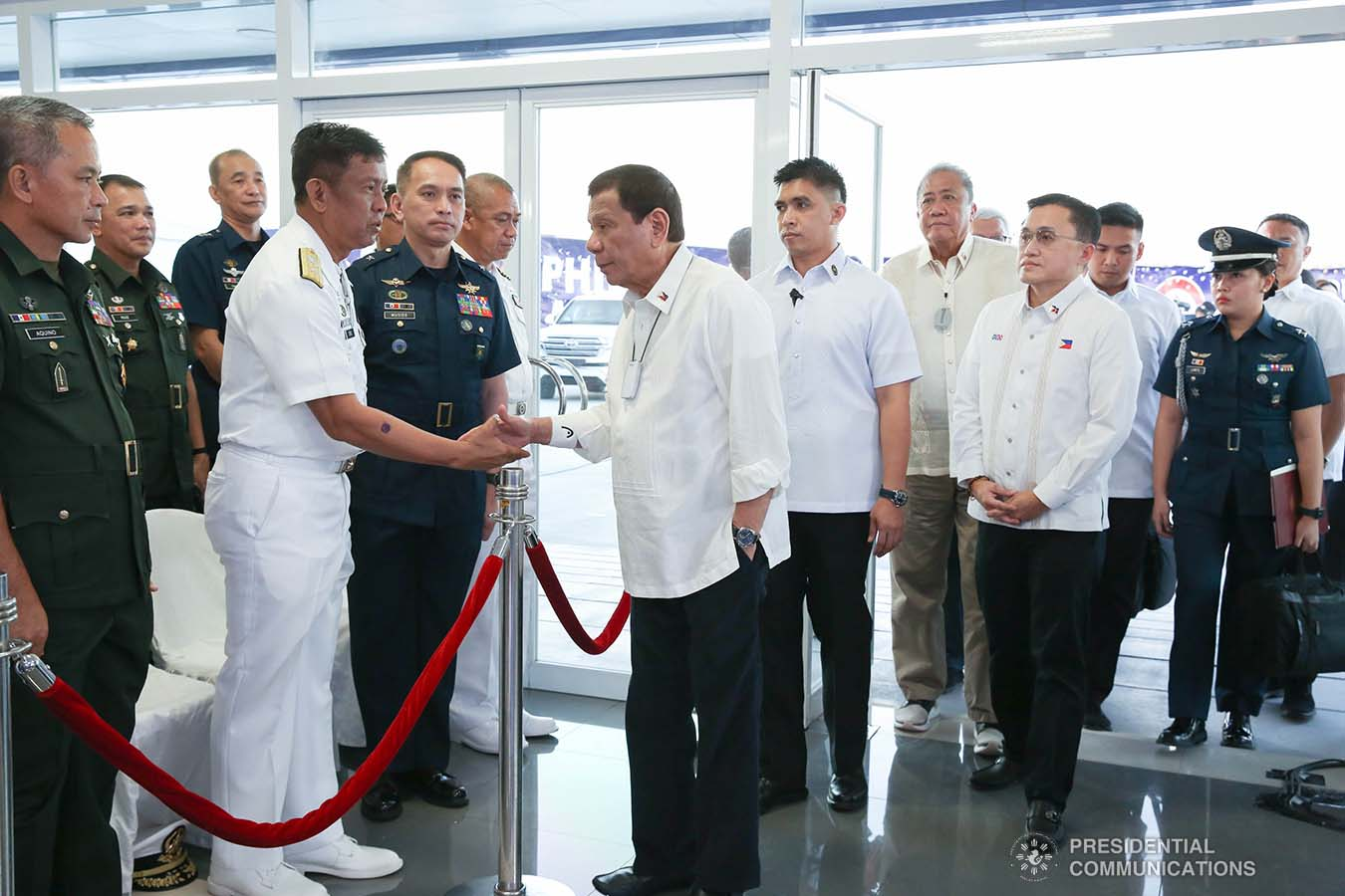 President Rodrigo Roa Duterte greets a Philippine Navy official upon his arrival at the Sangley Airport in Cavite City for its inauguration on February 15, 2020. ALBERT ALCAIN/PRESIDENTIAL PHOTO
