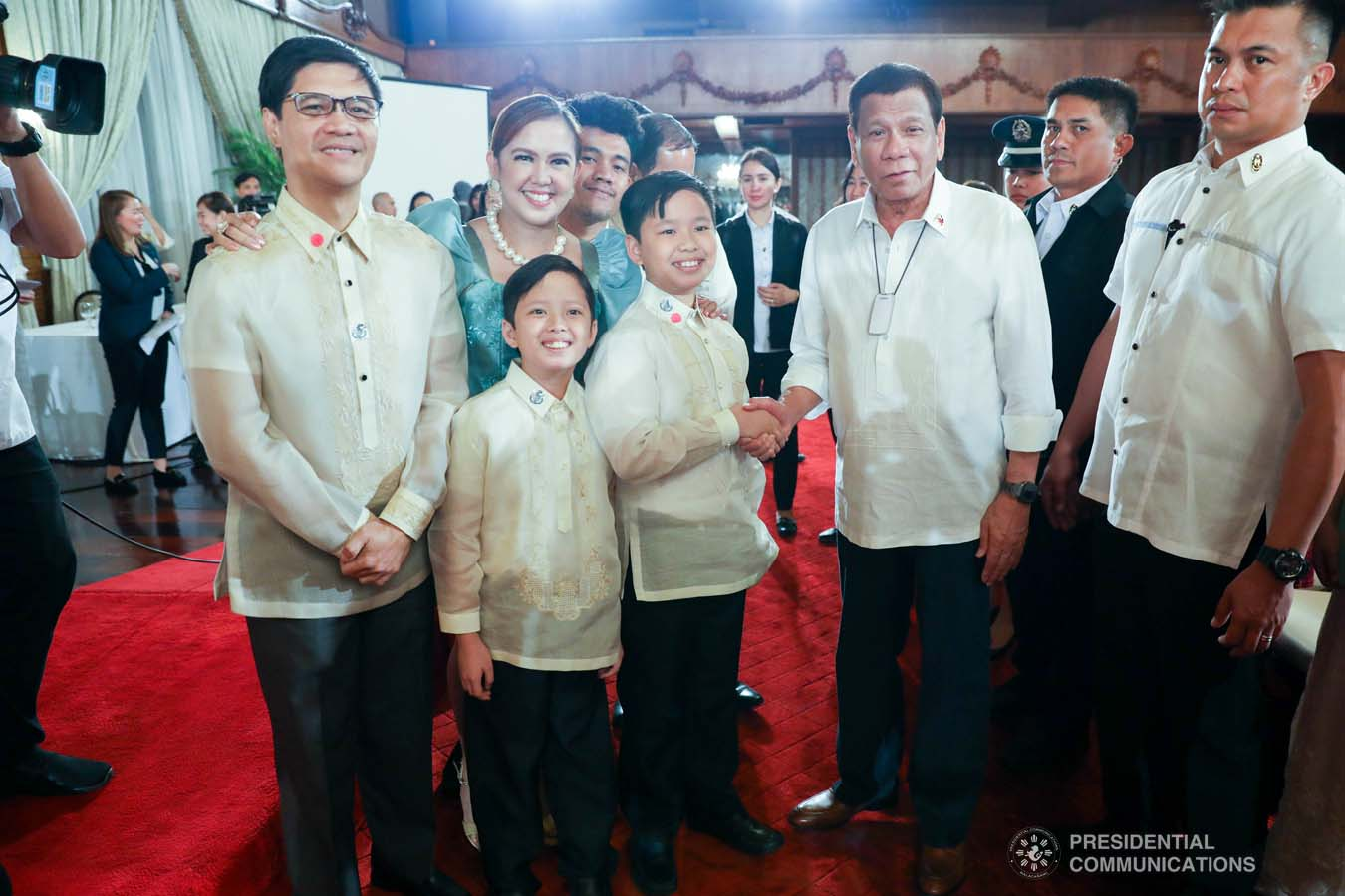 President Rodrigo Roa Duterte poses for posterity with one of the 12th Ani ng Dangal awardees during the presentation of awards at the Malacañan Palace on February 26, 2020. SIMEON CELI JR./PRESIDENTIAL PHOTO