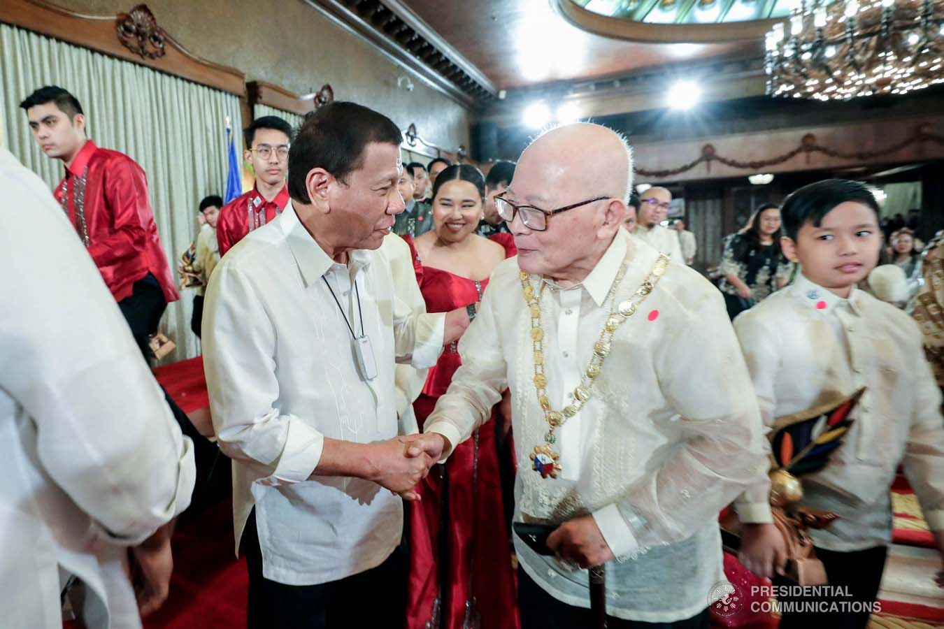 President Rodrigo Roa Duterte shares a light moment with one of the 12th Ani ng Dangal awardees during the presentation of awards at the Malacañan Palace on February 26, 2020. RICHARD MADELO/PRESIDENTIAL PHOTO