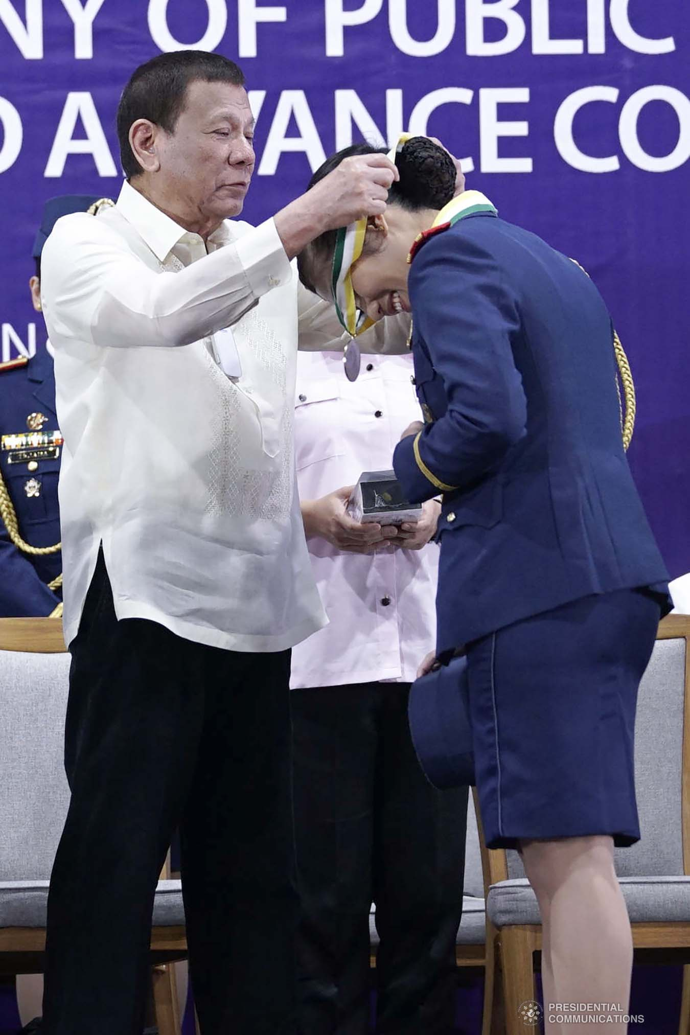 President Rodrigo Roa Duterte confers a medal to one of the awardees during the joint graduation ceremony of Public Safety Officers Basic Course Class 2019-07 and Advance Course Class 2019-18 at the Arcadia Active Lifestyle Center in Davao City on February 20, 2020. ARMAN BAYLON/PRESIDENTIAL PHOTO