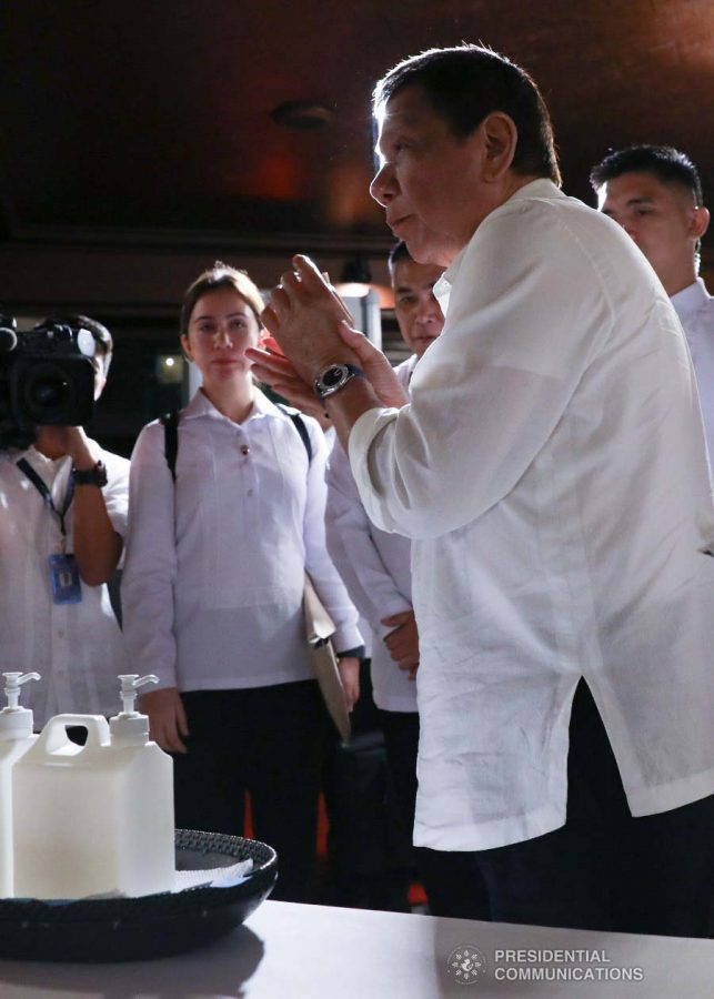 President Rodrigo Roa Duterte cleans his hands with sanitizer before heading to the Heroes Hall of Malacañan Palace to hold a briefing on the 2019 novel Coronavirus (2019-nCoV) on February 3, 2020. TOTO LOZANO/PRESIDENTIAL PHOTO