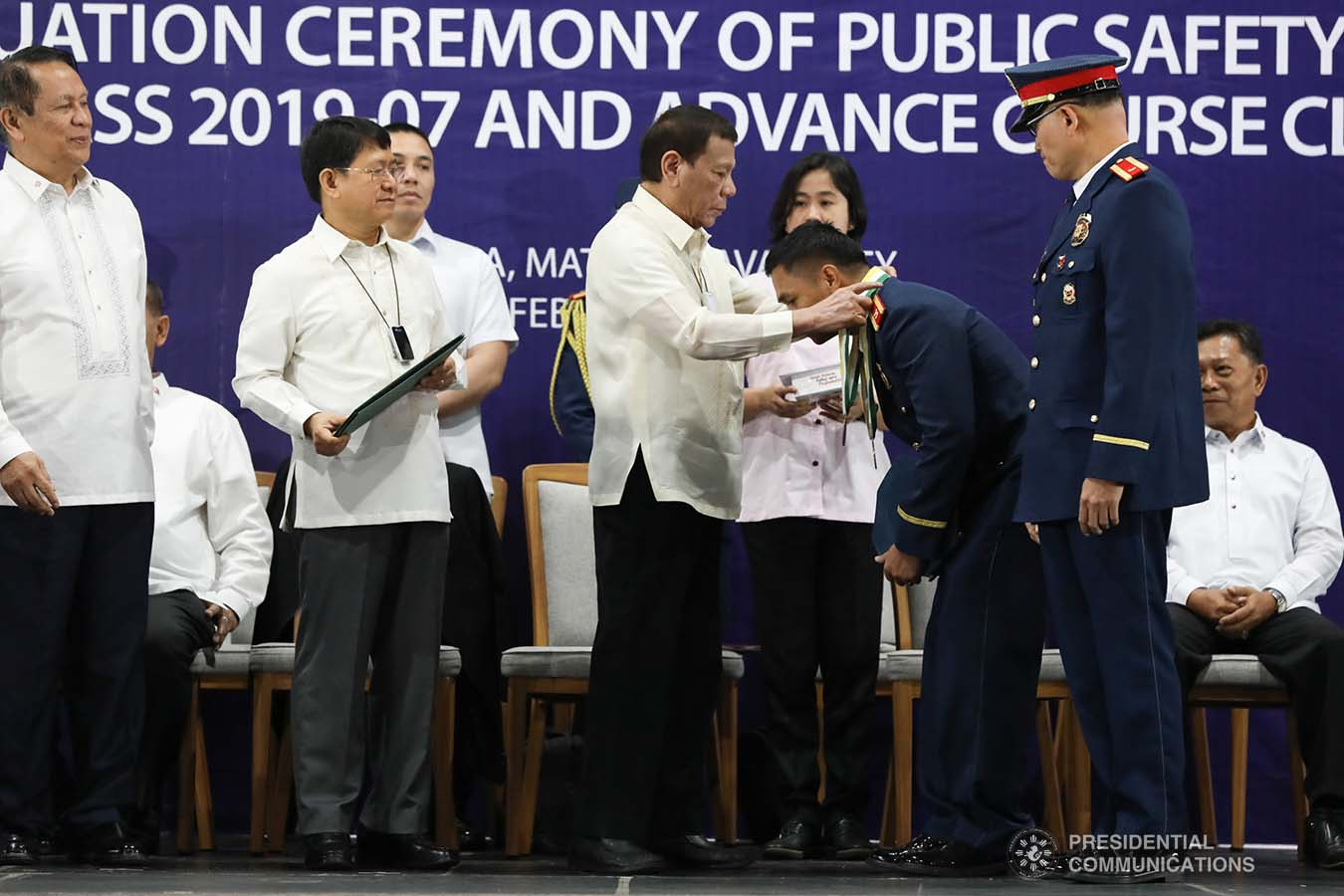 President Rodrigo Roa Duterte confers a medal to one of the awardees during the joint graduation ceremony of Public Safety Officers Basic Course Class 2019-07 and Advance Course Class 2019-18 at the Arcadia Active Lifestyle Center in Davao City on February 20, 2020. TOTO LOZANO/PRESIDENTIAL PHOTO