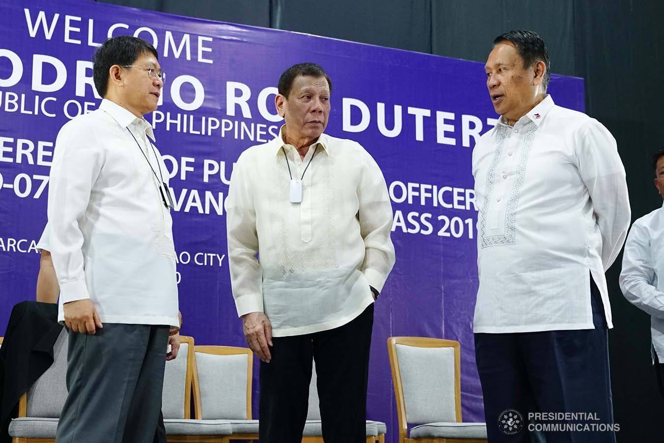 President Rodrigo Roa Duterte chats with Interior and Local Government Secretary Eduardo Año and Philippine Public Safety College President Ricardo De Leon on the sidelines of the joint graduation ceremony of Public Safety Officers Basic Course Class 2019-07 and Advance Course Class 2019-18 at the Arcadia Active Lifestyle Center in Davao City on February 20, 2020. JOEY DALUMPINES/PRESIDENTIAL PHOTO