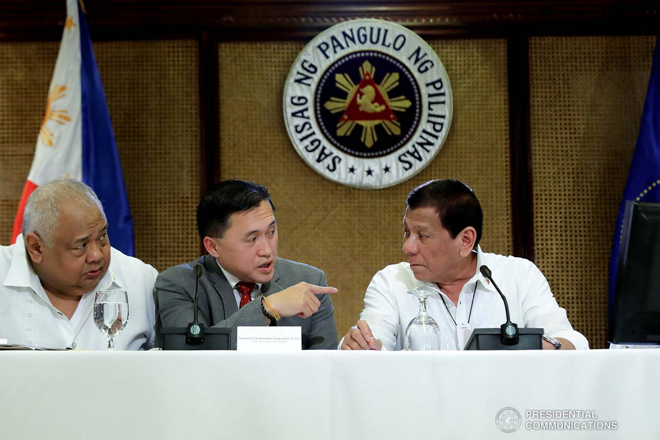 """President Rodrigo Roa Duterte confers with Executive Secretary Salvador Medialdea and Senator Christopher """"Bong"""" Go during a meeting with the Inter-Agency Task Force for the Management of Emerging Infectious Diseases at the Malacañan Palace on March 9, 2020."""