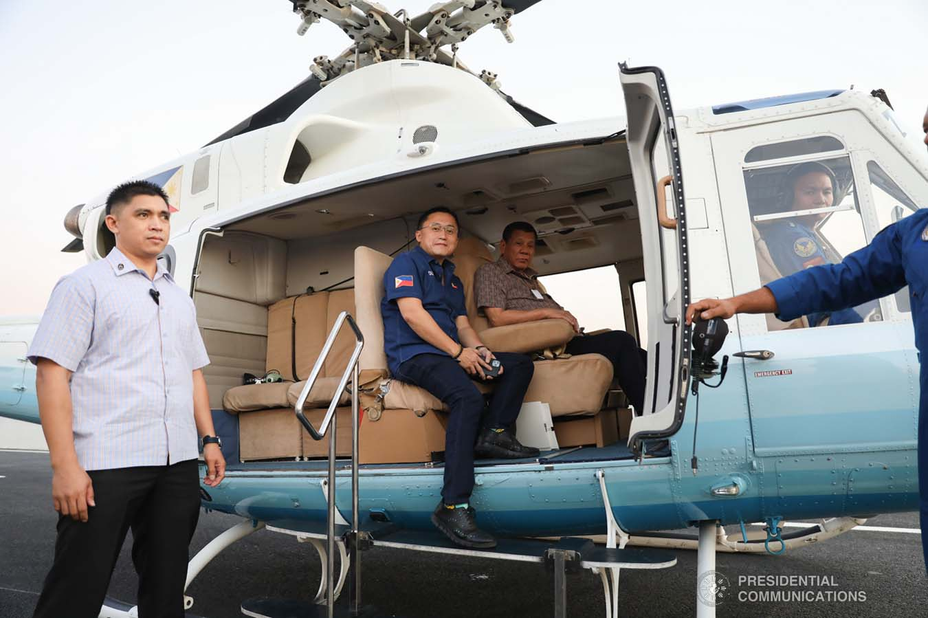 """President Rodrigo Roa Duterte boards a chopper with Senator Christopher """"Bong"""" Go as he prepares to lead the inspection of the North Luzon Expressway (NLEX) Harbor Link Circumferential Road 3 (C3)-R10 Section in Caloocan City on March 5, 2020. SIMEON CELI JR./PRESIDENTIAL PHOTO"""